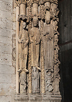 Originally thought to be Abraham, his wife Sara and her servant Hagar, but now thought to be 2 kings and a young princess, benefactors of the cathedral, from the left splay of the left bay of the Royal Portal, 1142-50, Western facade, Chartres cathedral, Eure-et-Loir, France. Chartres cathedral was built 1194-1250 and is a fine example of Gothic architecture. It was declared a UNESCO World Heritage Site in 1979. Picture by Manuel Cohen.