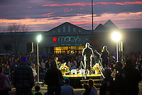 BURLINGTON, WA - SEPTEMBER 26: Hundreds gather for a candlelight vigil led by Mike Acker (left) pastor of Citipoint Church, with Aaron Willsie (right) outside the Cascade Mall on September 26, 2016 in Burlington, Washington. Behind them is the Macy's department store where five people were shot and killed by a gunman several nights ago. The suspect, Arcan Cetin, 20, a resident of Oak Harbor, Washington, made a court appearance today. (Photo by Karen Ducey/Getty Images)