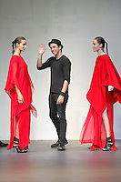 "Fashion designer Mike Vensel walks the runway with two modes at the close of his Mikevensel Fall/Winter 2011 ""Mies Maasai"" collection outfit my Mike Vensel, during CONCEPT New York Fashion Week."