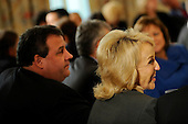 Governor Jan Brewer (Republican of Arizona) attends the National Governors Association meeting in the White House State Dining Room, with Governor Chris Christie (Republican of New Jersey) on Monday, February 27, 2012, in Washington, DC. .Credit: Leslie E. Kossoff / Pool via CNP