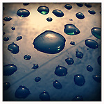 Raindrops reflect off a car in Venice, Calfirnia
