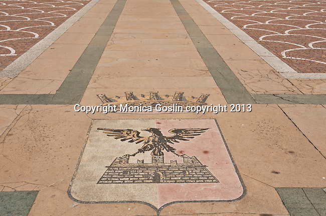 Pattern and crest on the floor of the Quadrio Place, plaza in front of the Madonna di Tirano Basilica in Tirano, Italy