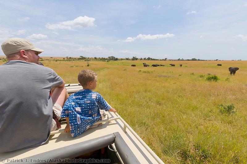 Tourists watch elephants in the Masa Mara, Kenya, East Africa