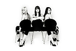 Black and White portrait of Girlband True Envy. Shot in homage to the  iconic 1960s Lewis Morley portrait of Christine Keeler