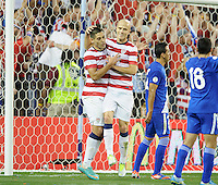 Kansas City, Kansas, October 16, 2012: The USA 3-1 over Guatemala at Livestrong Sporting Park in the semi-final round of 2014 FIFA World Cup Qualifying. Clint Dempsey is congratulated by Michael Bradley after scoring his second goal.