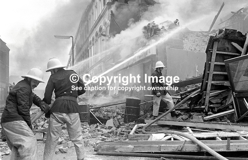 Firemen hose down the smouldering remains of the Chlorane Bar, Gresham Street, Belfast, N Ireland, following an explosion. On 5th June 1976, 10 days earlier, the bar had been the scene of a UVF gun attack in which 5 died, among them the owner, 64 year old James Coyle, from West Belfast. 1976061150315b..Copyright Image from Victor Patterson, 54 Dorchester Park, Belfast, UK, BT9 6RJ..Tel: +44 28 9066 1296.Mob: +44 7802 353836.Voicemail +44 20 8816 7153.Skype: victorpattersonbelfast.Email: victorpatterson@me.com.Email: victorpatterson@ireland.com (back-up)..IMPORTANT: If you wish to use this image or any other of my images please go to www.victorpatterson.com and click on the Terms & Conditions. Then contact me by email or phone with the reference number(s) of the image(s) concerned.