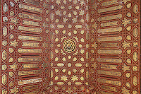 Painted coffered ceiling made under the Catholic kings after the reconquest in Mudejar style in the South side chamber of the Gilded Room or Cuarto Dorado, built under Mohammed V in the 14th century, in the Comares Palace, Alhambra Palace, Granada, Andalusia, Southern Spain. The Alhambra was begun in the 11th century as a castle, and in the 13th and 14th centuries served as the royal palace of the Nasrid sultans. The huge complex contains the Alcazaba, Nasrid palaces, gardens and Generalife. Picture by Manuel Cohen