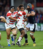 Kotaro Matsushima of Japan takes on the Scotland defence. Rugby World Cup Pool B match between Scotland and Japan on September 23, 2015 at Kingsholm Stadium in Gloucester, England. Photo by: Patrick Khachfe / Onside Images
