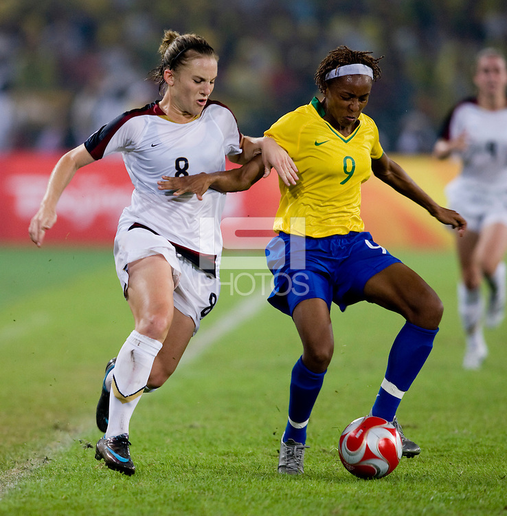 USWNT forward (8) Amy Rodriguez is shielded from the ball by Brazilian midfielder (9) Ester while playing for the gold medal at Workers' Stadium.  The USWNT defeated Brazil, 1-0, during the 2008 Beijing Olympic final in Beijing, China.