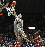 "Mississippi's Marshall Henderson (22) shoots against Georgia's Vincent Williams (11) at the C.M. ""Tad"" Smith Coliseum on Saturday, February 16, 2013. Mississippi won 84-74 in overtime. Henderson scored 25. (AP Photo/Oxford Eagle, Bruce Newman)"