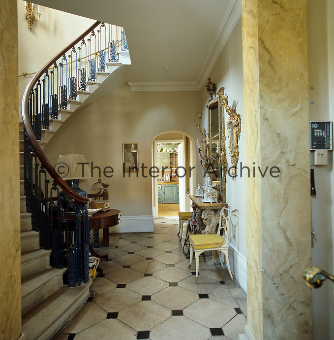 The entrance hall has a grand cantilevered staircase