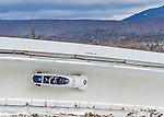 9 January 2016: Russian pilot Nikita Kakharov leads his 4-man team as they cruise through Curve 14 during their second run of the day at the BMW IBSF World Cup Bobsled Championships at the Olympic Sports Track in Lake Placid, New York, USA. Kakharov's team came in 10th for the day, with a 2-run combined time of 1:50.97. Mandatory Credit: Ed Wolfstein Photo *** RAW (NEF) Image File Available ***