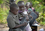 A girl writes the alphabet on a chalkboard--with help from a classmate--at the Loreto Primary School in Rumbek, South Sudan. The school is run by the Institute for the Blessed Virgin Mary--the Loreto Sisters--of Ireland.