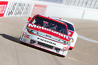 Feb. 3, 2012: Stock cars from Dale Jarrett Racing Adventure head toward turn one at Las Vegas Motor Speedway.