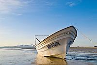Fishing boat on beach at low tide, San Felipe, Baja California, Mexico
