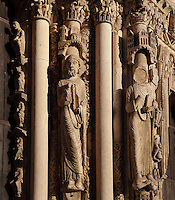 Moses, holding the tablets of the law, wearing a Jewish hat and with his feet crossed in the style of Languedoc sculptors, with one other mutilated statue with no face and the other 2 removed and replaced with plain columns, from the right splay of the left bay of the Royal Portal, 1142-50, Western facade, Chartres cathedral, Eure-et-Loir, France. Chartres cathedral was built 1194-1250 and is a fine example of Gothic architecture. It was declared a UNESCO World Heritage Site in 1979. Picture by Manuel Cohen.