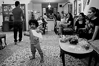 Teheran, Iran, October 2, 2007.'Iftar' (breaking the fast) at sunset, in the Mirza Agha Bakr family home. Sima, 3, full of energy, entertains the family.