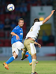 St Johnstone v FC Luzern...24.07.14  Europa League 2nd Round Qualifier<br /> Chris Millar heads clear<br /> Picture by Graeme Hart.<br /> Copyright Perthshire Picture Agency<br /> Tel: 01738 623350  Mobile: 07990 594431
