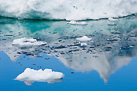 Open ocean between small and larger icebergs, Arctic Ocean.