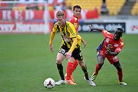 Shaun Timmins and Awer Mabil during the A League - Wellington Phoenix v Adelaide United, Wellington, New Zealand on Sunday 30 March 2014. <br /> Photo by Masanori Udagawa. <br /> www.photowellington.photoshelter.com.