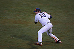 Ole Miss' Bobby Wahl (19) throws wildly to third for an error at Oxford University Stadium in Oxford, Miss. on Wednesday, February 23, 2011. Two Arkansas State runs scored on the play.