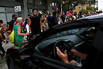 Andrew Speir, a member of the Black Bloc anarchist group, stares down a driver who got his car stuck in the middle of the street while protesters march through Tampa, Fla. during the 2012 Republican National Convention on August 27, 2012.