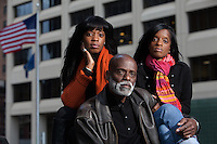 "New York, NY - November 05, 2013 : Veteran Scott Riley with his daughters Libra Riley-Johnson, left, and Hasha Riley, right, at the New York City Vietnam Veterans Memorial Plaza in New York, NY on November 05, 2013. Vet Scott Riley spent 30 years after her came back from Vietnam as a drug addict. Then he got clean and wrote a book--""Grace in the Wilderness"" with his two daughters."
