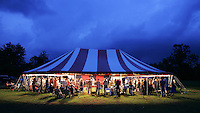 Threatening clouds pose little worries to patrons of a tent revival located in Wolftown, Va. Photo/Andrew Shurtleff