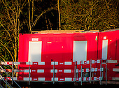 Bright red construction huts at Werdhölzli Sewage Treatment Plant, Zürich, Switzerland.