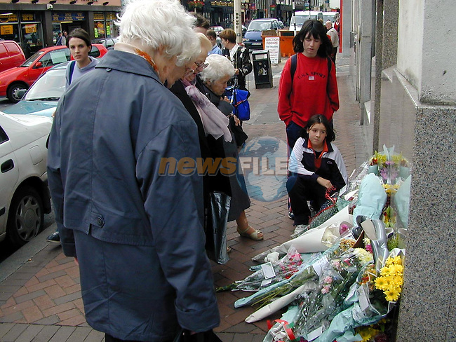 The floral tribute which was left outside the AIB Bank in memory of Don Briscombe..Picture Paul Mohan Newsfile