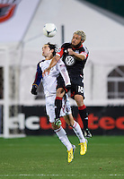 Nick DeLeon (18) of D.C. United goes up for header with John Stertzer (27) of Real Salt Lake during the game at RFK Stadium in Washington, DC.  D.C. United defeated Real Salt Lake, 1-0.