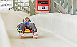 5 December 2014: Valentin Cretu, sliding for Romania, crosses the finish line on his first run, but ended the day disqualified in the Men's Competition at the Viessmann Luge World Cup, at the Olympic Sports Track in Lake Placid, New York, USA. Mandatory Credit: Ed Wolfstein Photo *** RAW (NEF) Image File Available ***
