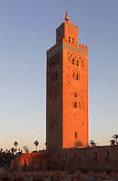 Koutoubia mosque, Medina, Marrakech, Morocco. The mosque was completed in the reign of the Almohad Caliph Yaqub al-Mansur, 1184-1199. The minaret stands 77m tall and is built of sandstone bricks, topped with copper orbs. It is the largest mosque in Marrakech. Picture by Manuel Cohen