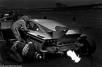 A Goodyear tire engineer checks tread depth during a pit stop for the Porsche 935 K3 driven by Dale, Don and Bill Whittington in the 1980 race. The trio finished 16th.