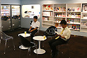 July 27, 2010 - Tokyo, Japan - Japanese people sit in a waiting room at the Akihabara Blood Donation Center in Tokyo, Japan, on July 27, 2010. Also called 'Akiba:F', the blood donation facility opened on October 2009 and has free wifi, figure display cases, shelves of manga, and video screens that will show movies, to help people relax and feel comfortable.