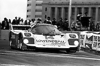 COLUMBUS, OH - OCTOBER 6: Al Holbert drives his Holbert Racing Porsche 962 HR1 during the Columbus Ford Dealers 500 IMSA GTP/Lights race at the temporary Columbus Street Circuit in Columbus, Ohio on October 6, 1985.