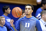 04 November 2014: Duke freshman Tyus Jones warms up before his first basketball game at Cameron Indoor. The Duke University Blue Devils hosted the Livingstone College Blue Bears at Cameron Indoor Stadium in Durham, North Carolina in an NCAA Men's Basketball exhibition game.