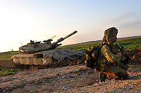 Israeli infantry soldiers and a tank enter Gaza. Israeli forces began an air offensive against Hamas in Gaza on 27/12/2008, which quickly escalated into an offensive by land, sea and air, in retaliation against Palestinian rockets fired into Israel. After eight days of bombardment, leaving over 400 Palestinians and four Israelis dead, Israeli tanks entered Gaza on 04/01/2009...