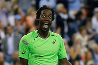 Gael Monfils of France reacts after hitting a return to Roger Federer of Switzerland during their quarter-final game at the US Open 2014 tennis tournament at the USTA Billie Jean King National Center in New York.  09.04.2014. VIEWpress