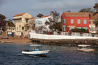 Houses along Goree Island Waterfront, Senegal.  Hostellerie du Chevalier de Boufflers (red building), a small hotel, on the right.