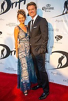 "Caves House Yallingup, Western Australia (Thursday, March 22, 2013) Leading actor and producer Myles Pollard (AUS) with wife Brigitta Wuthe (AUS). - .Over 60 metres of red carpet greeted the  1300 guests at the Australian premiere of the surfing movie, Drift, which was shot in Margaret River region and  screened under the stars at Caves House, Yallingup last night...The movie's major celebrity  Sam Worthington was absent from the opening but other big names including Xavier Samuel, fresh from his turn in the Twilight saga, and former McLeod's Daughters actor  Myles Pollard enjoyed the red carpet attention...The premiere will took the film back to its roots in WA's rugged and beautiful South-west region, with a large outdoor screening for over 1,300 people  held in the historic gardens at Caves House in Yallingup. .Drift - A story of passion, corruption, friendship and loyalty, deadly addictions and fractured relationships, tells a tale of courage and the will to survive at all odds...The Australian premiere of Drift was a proud moment for two of the film's West Australian producers, Tim Duffy and Myles Pollard...Myles, who also plays a leading character in the film, was excited to premiere the film to the local community...""We are ecstatic that the Australian premiere of Drift is happening in the South-west. We have enormous respect for the local community that supported the movie and we're so happy to bring the spotlight back to the region for what promises to be a memorable and historical event,"" he said...Walking the red carpet were the film's cast, co-directors Morgan O'Neill and Ben Nott, producers Tim Duffy, Myles Pollard and Michele Bennett, local WA crew, local dignitaries and investors, and over 300 extras from the region who feature in Drift...The timing of the premiere coincided with the 2013 Margaret River Pro surfing tournament with many of the world's best surfers attending such as Taj Burrow (AUS), Martin Potter (UK) and former WCT surfer Jake Paterso"
