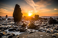 Sunset over rock formations near Rapahoe near Greymouth, West Coast, Buller Region,  New Zealand
