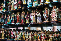 Catholic devotional objects for sale seen in a religious shop in Bogota, Colombia, May 27, 2010. About 80% of the population in Colombia identify themselves as followers of the Catholic religion. Colombians are among the most devout of Latin American Catholics. Colombian Catholic church is renowned as one of the most conservative and traditional in Latin America, having traditionally been associated with elite structures in the society.
