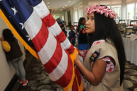 NWA Democrat-Gazette/FLIP PUTTHOFF <br /> Henity Harry (cq) gets ready Saturday April 30, 2016 to bring the American Flag into the convention of the American Association of University Women. Girl Scouts from Troop 5132 in Springdale posted the colors at the gathering.