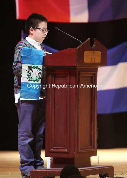 WATERBURY CT. 26 October 2015-102715SV07-Jefferson Garcia of Waterbury reads his project on Guatemala during the annual Hispanic Heritage Month celebration at Crosby High in Waterbury Tuesday. Students from around the district gathered at Crosby High School to watch performances of Hispanic culture by students of all ages.  <br /> Steven Valenti Republican-American