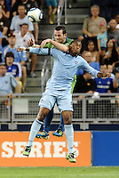 Zach Scott (20) defender Seattle Sounders and Teal Bunbury (9)  forward Sporting KC in an aeriel battle... Sporting Kansas City were defeated 1-2 by Seattle Sounders at LIVESTRONG Sporting Park, Kansas City, Kansas.
