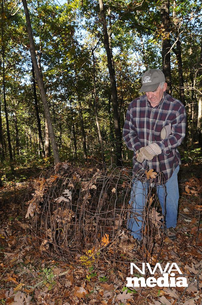 NWA Democrat-Gazette/FLIP PUTTHOFF <br /> Ken French of the Lake Wedington area removes old fencing Oct. 21 2016 during a Northwest Arkansas Master Naturalists work day at Sweden Creek Falls Natural Area.