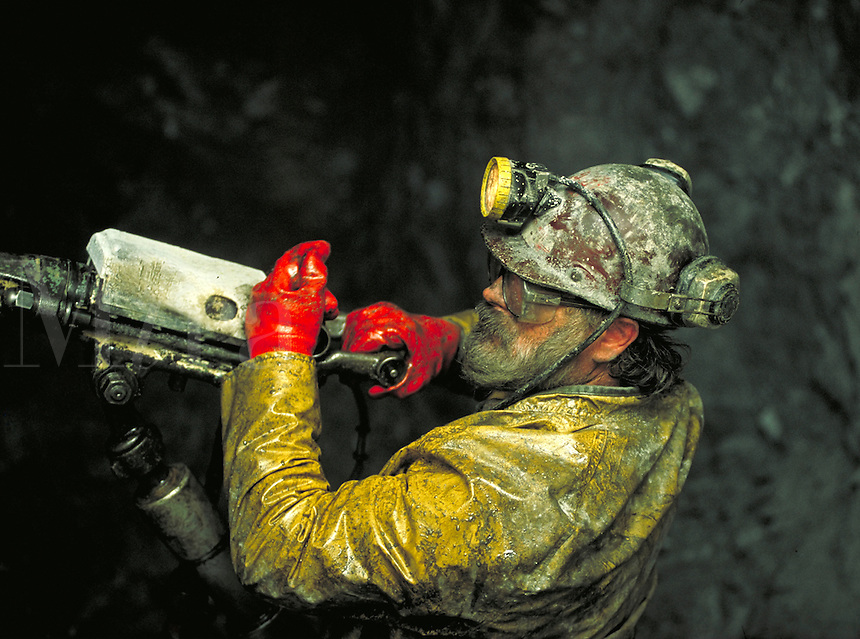 A miner uses a jackleg drill inside Greens Creek Mine on Admiralty Island, Alaska. (Southeast Alaska). Alaska, Greens Creek Mine, Admiralty Island, Southeast Alaska.