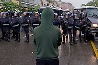 Milano 1 Maggio 2015<br /> Mayday  NoExpo  <br /> Scontri manifestanti polizia durante la manifestazione a Milano,contro l'apertura dell'Esposizione universale Milano 2015. Manifestante fronteggia la polizia<br /> Milan, May 1, 2015<br /> Mayday NoExpo<br /> Clashes  protesters against police during the demonstration in  downtown Milan, to protest against Universal Exposition Milano 2015. Protester faces police