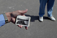 25 April 2004 - Arromanches, France - British veteran Harry Daley (L, partially hidden) - visiting the village of Arromanches, France, with his wife, 25 August 2005 - shows photographs taken during his own landing barge in the summer of 1944.
